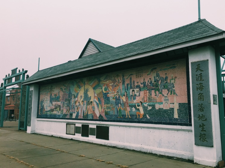 Chinese in America Mural: Statue of Liberty & Golden Gate bridge represents adaptation of Eastern & Western values.